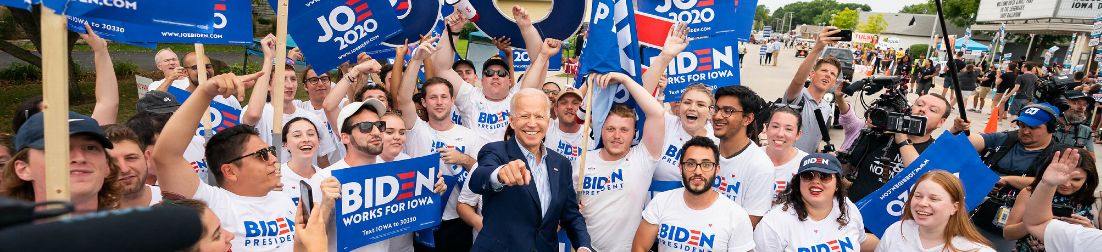 President, then candidate, Joe Biden surrounded by a crowd of supporters.